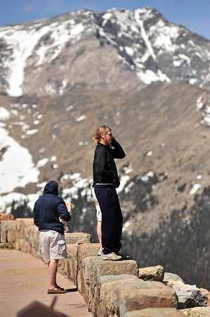 Walt Hester | Trail Gazette<br /> Sara McKown enjoys the view from Rainbow Curve on Monday. McKown was enjoying her first visit to Trail Ridge Road with a nearly bare Mount Ypsilon behind her.