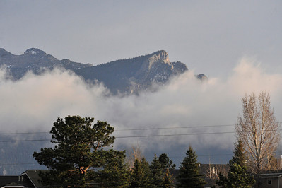 Walt Hester | Trail Gazette Low clouds roll in and out of Estes Park on Wednesday. While Friday should be pleasant, the weekend may bring much needed rain and snow to Estes Park