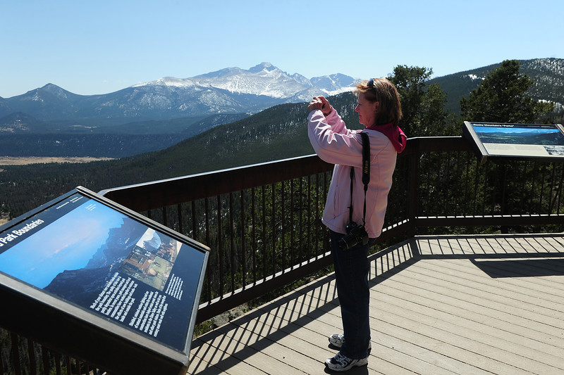 Walt Hester | Trail Gazette<br /> Marilyn Chemlock of Powhatin, Va., takes video of the view from Many Parks Curve on Monday. In most years, this was as high as a visitor could drive on Trail Ridge Road.