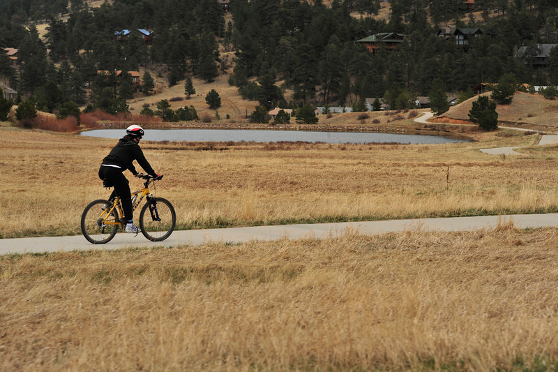 Walt Hester | Trail Gazette<br /> A cyclist glides along the paved trail along Carriage Drive on Wednesday. Trails all over Estes Park shoud be dry and clear on Friday, though Saturday could bring precipitation.