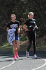 Walt Hester | Trail Gazette<br /> Erin Barker and Sara Speedlin recover from a workout on Monday. The pair were part ofthe team's 4x800 meter relay who finished fourth in their heat and in the top 18 in the meet.