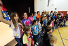 Walt Hester | Trail Gazette<br /> Estes Park fourth-graders wave flashlights and sing of space at the school's gym on Tuesday. The children perform their annual music program at the elementary school beginning at 7 p.m. on Thursday.