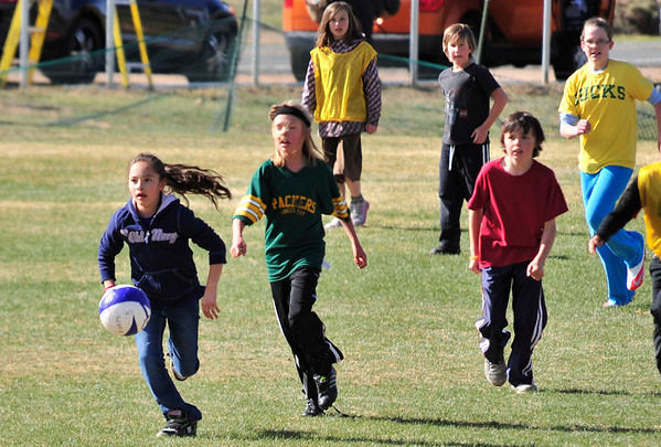 Walt Hester | Trail Gazette<br /> Children chase a soccer ball during a game on Monday. The Estes Valley Recreation and Parks District are ramping up their youth outdoor activities at the Stanley Park ball fields.