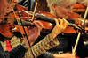 Walt Hester | Trail Gazette<br /> Fingers fly on violins during the Estes Park Oritorio Society's Monday rehearsal. The spring concert is scheduled for Friday, April 20, and Saturday, April 21, at the Mountain View Bible Fellowship.