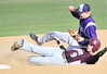 Walt Hester | Trail Gazette<br /> Estes Park's Dylan Jirsa gets knocked down by a Berthoud baserunner during Thrursday's 12-1 loss to the visiting Spartans. The loss was the 'Cats' second in a row after a two-win streak.