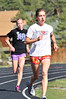 Walt Hester | Trail Gazette<br /> Kelsi Lasota and Holli Holmes work out on Monday. Lasota placed eighth in the 3200 meters at the Runners Roost Invitational on Saturday, a meet that gives athletes of all school classes a chance to compete against each other.