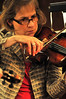 Walt Hester | Trail Gazette<br /> Violinist Barbara Barber focuses on the work during Monday's rehearsal. Barber will perform a solo during the weekend concert.