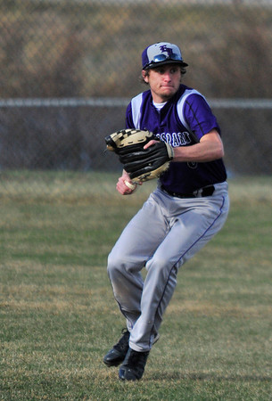 Walt Hester | Trail Gazette<br /> Outfielder David Klein looks for a target during Thursday's game against Berthoud. The Bobcats suffered another loss on Friday, 21-11, to the Mead Mavericks.