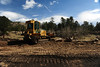 Walt Hester | Trail Gazette<br /> A bulldozer moves dirt and rocks along the side of Bear Lake Road on Wednesday. Work continues in the road through the visitors season.