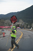Walt Hester | Trail Gazette<br /> A flag man turns his sign to let traffic pass on Big Thompson Avenue on Wednesday. Construction season is in full swing with the road projects on Big Thompson, Virginia Avenue, around Bond Park and in th enational park.