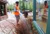 Walt Hester | Trail Gazette<br /> Rich Fall sprays fertilizer on plants in Riverside Plaza on Wednesday. The town is continuing to ready for the first big visito weekend, Duck Race weekend.