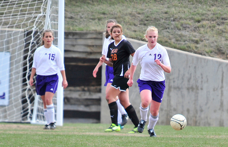 Walt Hester | Trail Gazette<br /> Senior defender Carmen Laing clears the ball out against Mead on Friday. Due to a scheduling snafu, the Ladycats seniors will have one more chance to play in front of the home crowd next week.