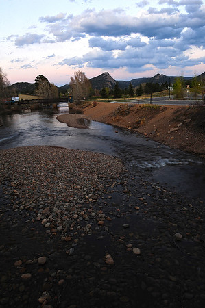 Walt Hester | Trail Gazette<br /> The Big Thompson River rolls east as clouds collect over Mount Olympus on Tuesday evening. The river is slowly rising as high country snow melts away.