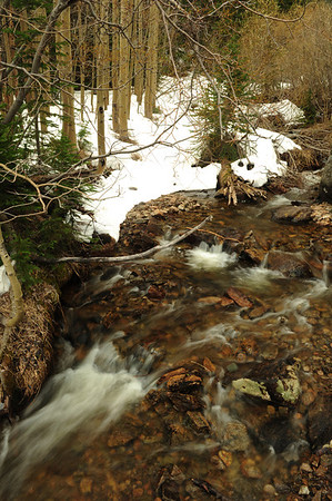Walt Hester | Trail Gazette<br /> Snow slowly melts off along the Glacier Creek on Wednesday The spring melt may slow over the weekend as temperatures drop back into the 50s.