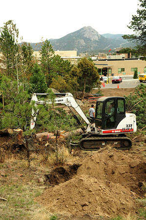 Walt Hester   Trail Gazette<br /> Excavation crews clear brush adjacent to the EPMC upper parking lot on Wednesday. The medical center plans to expand their parking.
