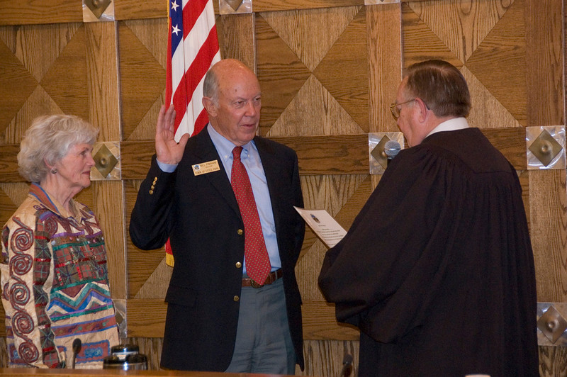Estes Park mayor Bill Pinkham, center, takes the oath of office from Municipal Judge Gary Brown April 24 while the mayor's wife Sue looks on.