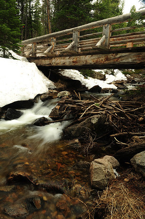 Walt Hester   Trail Gazette<br /> The Glacier Creek runs ever faster on Wednesday as warm temperature melt the winter snow in Rocky Mountain National Park. The melt has begun earlier this year with temperatures in the 70s.