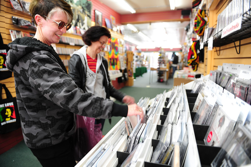 Walt Hester | Trail Gazette<br /> Karen Rae Anderson of Colorado Springs and Kris Goldston-Gallegos of Littleton look through CDs at Sgt. Peppers Music on Saturday. Saturday wasNational Music Store Day, encouraging shoppers to get out away from their computers and into brick-and motar stores.