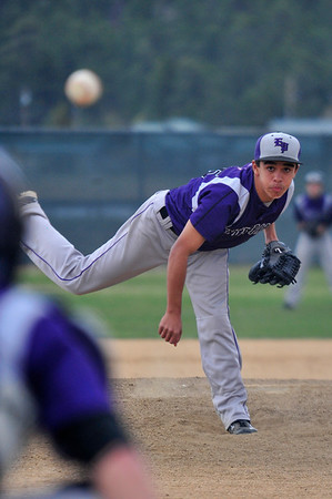 Walt Hester | Trail Gazette<br /> Bailey Flores watches his pitch in against Liberty Common on Wednesday. Flores gave up two runs early, then shut the Eagles down, striking out three in the two innings he pitched.