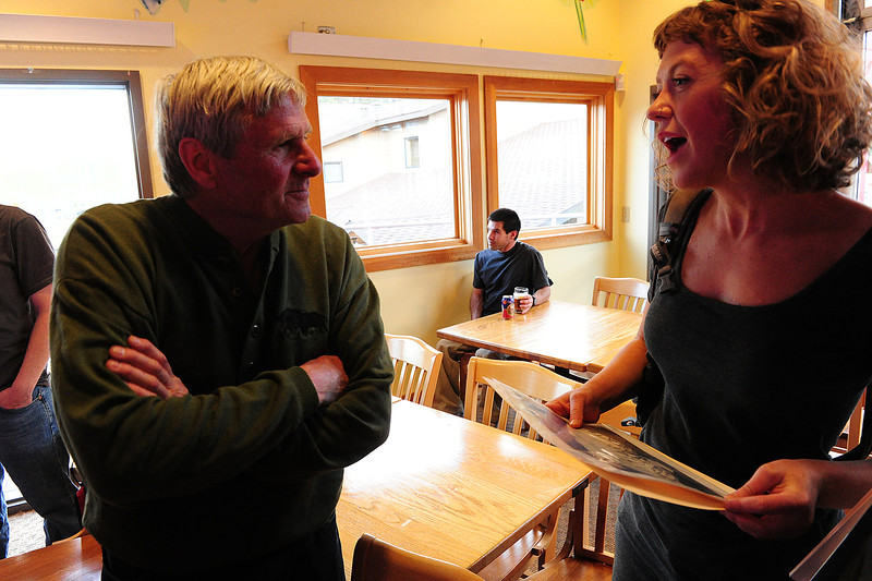 Walt Hester | Trail Gazette<br /> Climbing legend Gary Neptune listens to Joanna Spindler before Neptune's show at Ed's Cantina on Tuesday. Neptune was a rockclimbing pioneer and now runs a well-respected mountaineering shop in South Boulder.