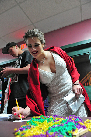 Walt Hester | Trail Gazette<br /> Jennifer Klink channels her inner movie star in her dress while signing up for a prize drawing. The after prom party featured prizes as well as games music and food.