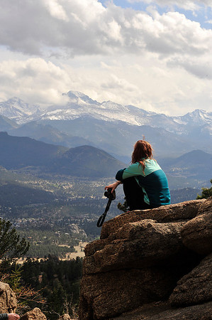 Walt Hester | Trail Gazette<br /> Jessica Warren of Chicago takes in the view of Longs Peak and Estes Park from the Gem Lake Trail on Tuesday. The Estes Park area is chalked full of spectacular views, drawing visitors from all over the nationa and the world.