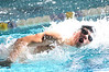 Walt Hester | Trail Gazette<br /> Luke Holmes swims through a shaft of light at Thursday's dual meet with Windsor. Holmes and the team head to Greeley in two weeks for their conference meet.