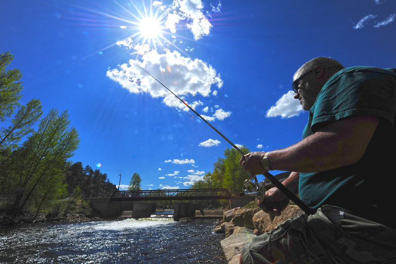 Walt Hester | Trail Gazette<br /> Carlos Albuquerque of Estes Park tosses a line into the Big Thompson River behind the Visitor Center on Wednesday.