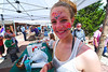 Walt Hester | Trail Gazette<br /> Ashley Knight, 12, of Fort Collins, ads extra spring to her face in Riverside Plaza on Sunday. Face Painting, a bake sale and musical entertainment occupied visitors at the finish line of the Duck Race.