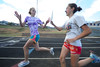 Walt Hester | Trail Gazette<br /> Holli Holmes takes the relay handoff from teammate Kellsi Lasota during practice on Wednesday. Both athletes are having great individual seasons and are part of the fourth-ranked 4x800 meter relay team.