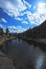 Walt Hester | Trail Gazette<br /> Sunshine breaks out from behind clouds above Gem Lake on Tuesday. Weekend weather is calling for rain and cooler temperatures, then a return to warmer weather next week.