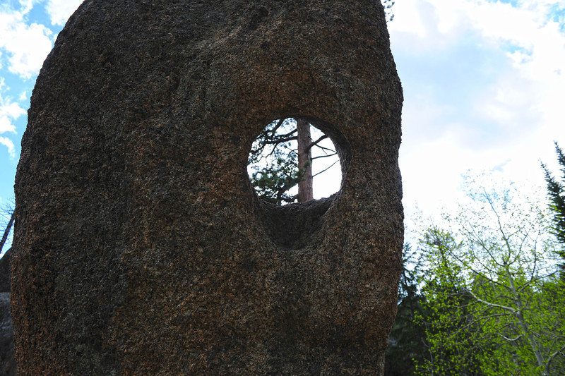Walt Hester | Trail Gazette<br /> The famous hole in the rock on the Gem Lake Trail coaxes hiker to explor the natural oddity. The hole was formed by centuries of ice, snow and water seeping into the rock.