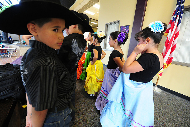 Walt Hester | Trail Gazette<br /> Young dancers line up to perform at the annual Cinco de Mayo festival at the Estes Park High School on Saturday. The festival came about with the efforts of the high school Spanish Club, the middle school's art classes, MacDonld Book Shop, El Mex-Kal, Mountain Home Cafe and Kind Coffee.
