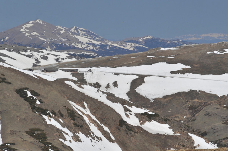 Walt Hester | Trail Gazette<br /> The Alpine Visitor Center, as well as the Wyoming Medicine Bow Range, far right, are visible from above Rock Cut on Monday. Last year, the visitor center was completely buried in snow.