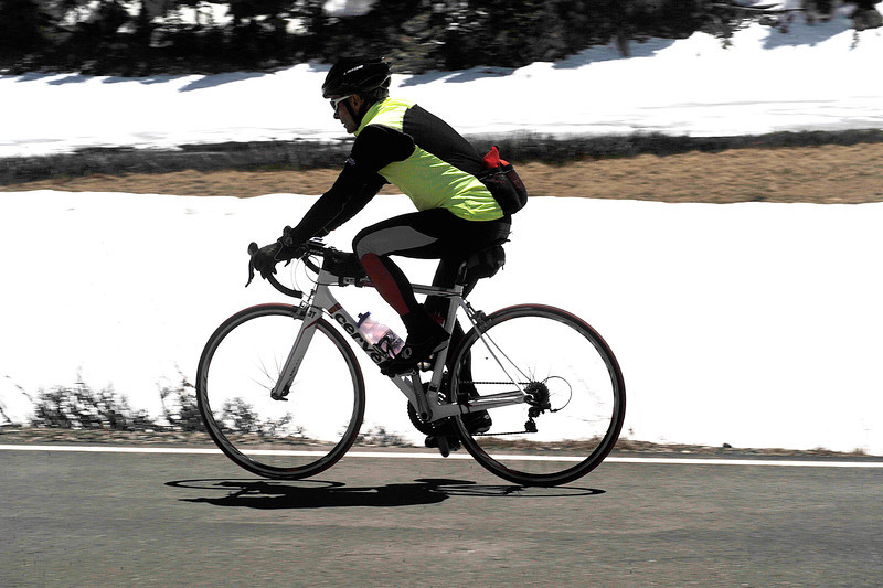 Walt Hester | Trail Gazette<br /> A cyclist cruises along Trail Ridge Road near Poudre Lake on Monday. While cyclists have been able to ride stretch of the road for weeks, the road's entire lenth was officially opened on Monday.
