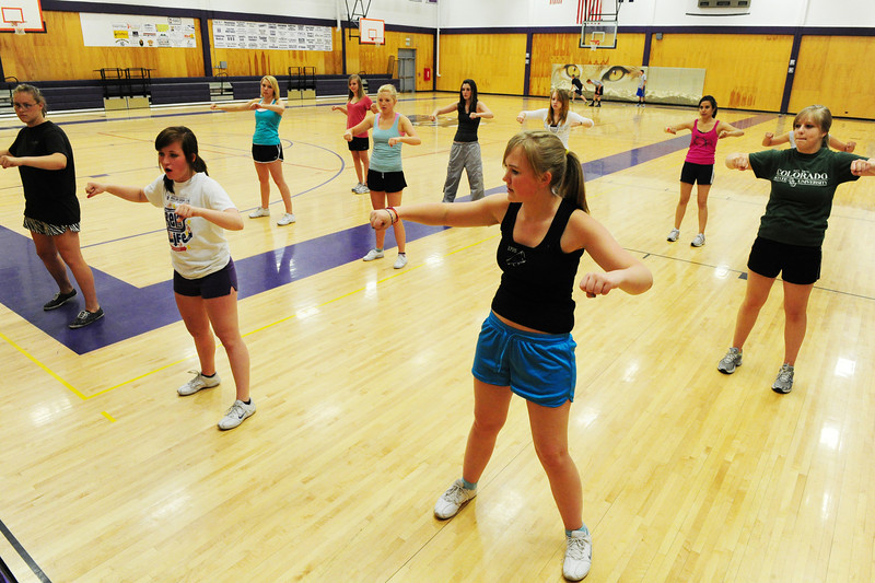 Walt Hester | Trail Gazette<br /> The Estes Park High School cheer squad helps new hopefuls with a routine on Wednesday. The squad was holding tryouts on Wednesday at the high school.