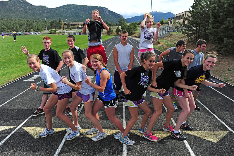 Walt Hester | Trail Gazette<br /> The Estes Park High School track and field athletes are ready for the State Meet this weekend. From front, left, they are Sara Speedlin, Holli Holmes, Laural Todd, Kelsi Lasota, Erin Barker, Faith Weibel, back left, Russ Hall, Noah Purdy, Andrew Cirone, Frankie KellerTwigg, Amanda Dill, Ian McLain and Josh Hays. Not pictured; Jeff Switzer.