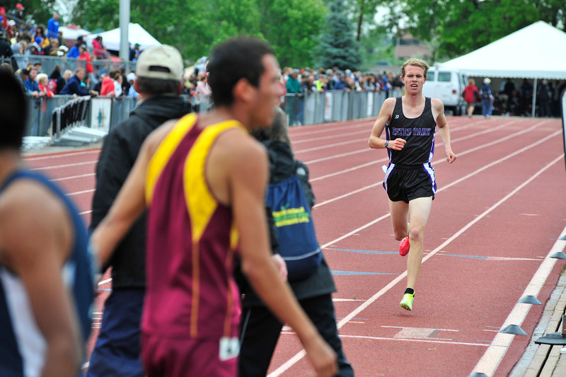 Walt Hester | Trail Gazette<br /> Jeff Switzer finishes an agonizing 1600 meters on Saturday. Switzer was tripped on Thursday during the 3200 meters, resulting in injuries that kept him from finishing the first race and causing a painful run in the second.