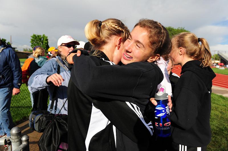 Walt Hester | Trail Gazette<br /> Sophomore distance runner Kelsi Lasota hugs team mate, senior Sara Speedlin, after the last event of the 2012 State Track and Field meet in Lakewood on Saturday.