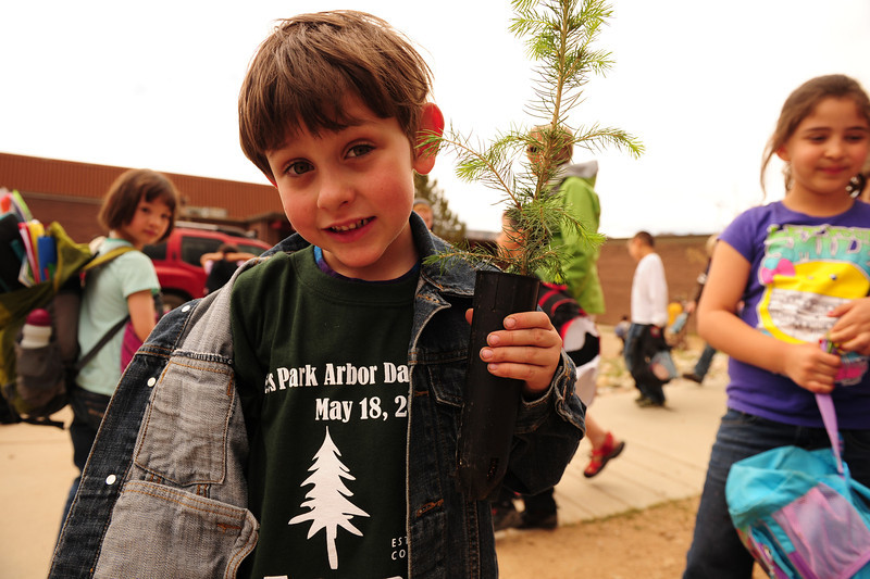 Walt Hester | Trail Gazette<br /> Joseph Kelly, 6, holds his tree that he was given as part of the elementary school and town's celebration of Arbor Day on Friday. The holiday, started in Nebraska, celebrates trees and what they do to beautify and preserve the landscape.