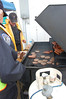 Estes Park Police Dept. Sgt. Rick Life, right, loads a tray with freshly barbecued hamburgers and hotdogs at the May 19 safety fair and expo.
