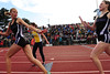 Walt Hester | Trail Gazette<br /> Sara Speedlin reaches back for the batton from 4x400 lead-off runner Faith Weibel. Individually, both girls gained success this season, but they did even better as a team.