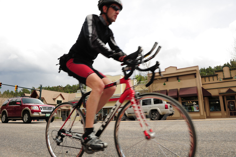 Walt Hester | Trail Gazette<br /> A cyclist trundles up Elkhorn Avenue on Sunday. With the warmer weather, more cyclists are making the trip to Estes Park.