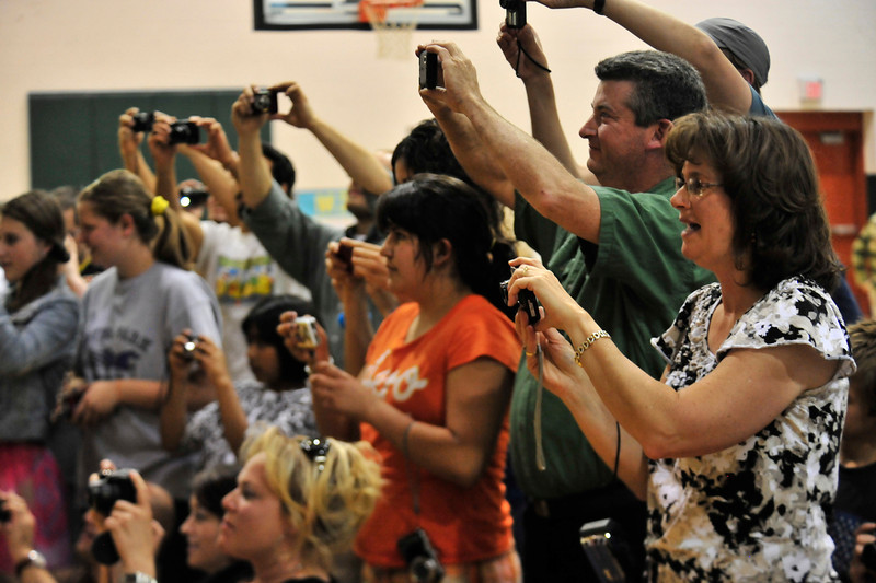 Walt Hester | Trail Gazette<br /> Proud parents take photos of their fifth-graders at the elementary school's promotion ceremony on Tuesday. The event celebrates students' promotion to middle shool next fall.