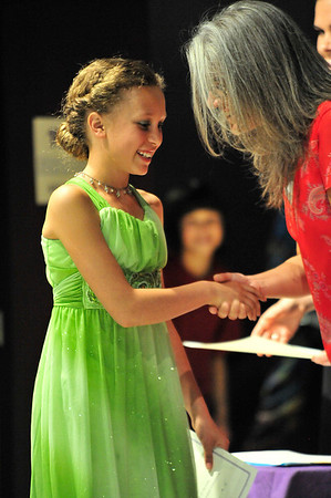 Walt Hester | Trail Gazette<br /> Chloe Burke smiles as she shakes hands with elementary school principal Karen Glassman at Tuesday night's fifth-grade promotion ceremony. The annual event celebrates the transition from elementary to middle school.