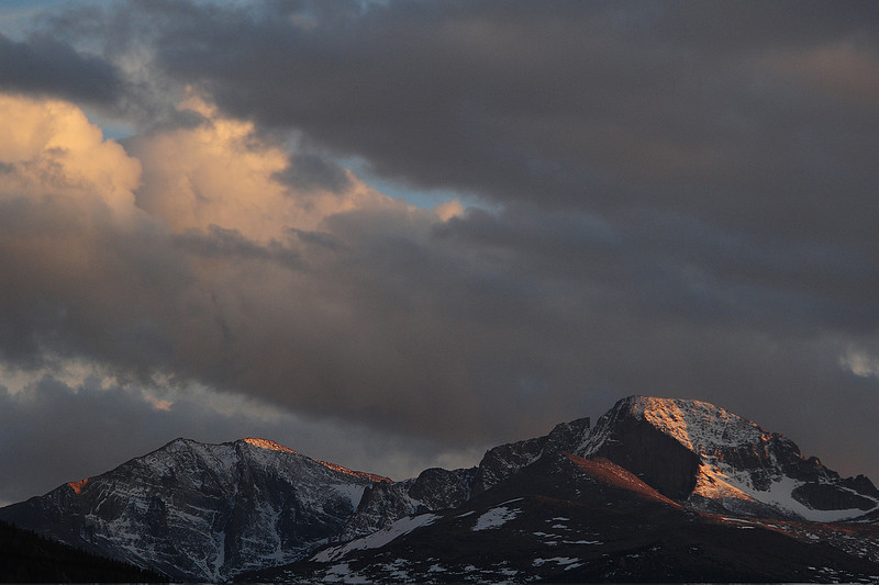Walt Hester | Trail Gazette<br /> Ominous, though colorful, clouds roll over Longs Peak and Estes Park on Sunday. Rain could return on Wednesday and Thursday, though temperatures should remain in the 60s.