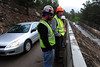 Walt Hester | Trail Gazette<br /> Project manager Joe Arnold, middle with orange helmet, talks about the Bear Lake Road project with project superintendent Robert Morales on Wednesday. The project will make the road both wider and safer for visitors.