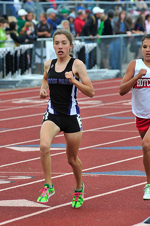 Walt Hester | Trail Gazette<br /> Kelsi Lasota passes a rival during the 1600 meters final on a wet and cold Saturday. Lasota took bronze in the race.