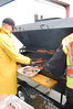 Estes Park Police Dept. Sgt. Rick Life barbecues hamburgers and hotdogs at the May 19 safety fair and expo.