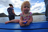 Walt Hester | Trail Gazette<br /> Chloe Everson, one-and-a-half-year old, of Sheboygan, Wis., tries to stay occupied while her family casts lines in the fishing derby. The derby is a big family event on the lake every year.